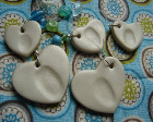 Heart-shaped pendants with fingerprints in the middle