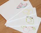 Cards with embroidered fruit designs on them.