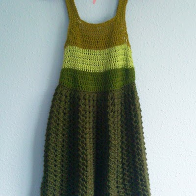 A knit, a-line dress in different shades of green.