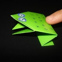 An origami frog made from green paper