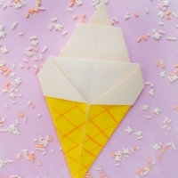 Origami ice cream cone with yellow paper for the cone and white for the ice cream