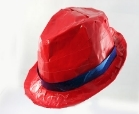 A duct tape fedora hat made from red duct tape with a blue stripe around the rim