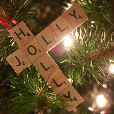 A Christmas tree ornament made from Scrabble tiles glued together