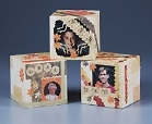 Styrofoam cubes covered in photos and scrapbooking paper