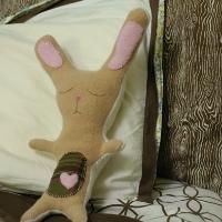 A sewn, stuffed bunny on a pillow