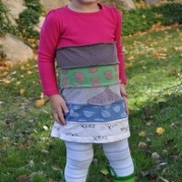 A ruffled, layered dress made from strips of old t-shirts