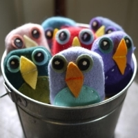 Little bean bag birds made of fabric and felt in a silver bucket