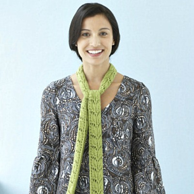A green lace scarf knitted at the top