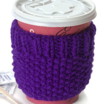 A purple cup cozy to be wrapped around a travel mug