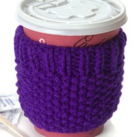 A green cozy to be wrapped around a travel mug