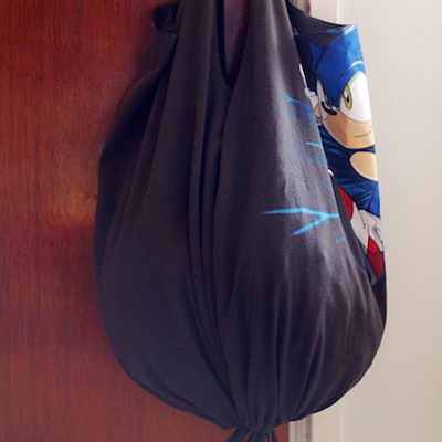 A drawstring tote bag made from an old, gray t-shirt