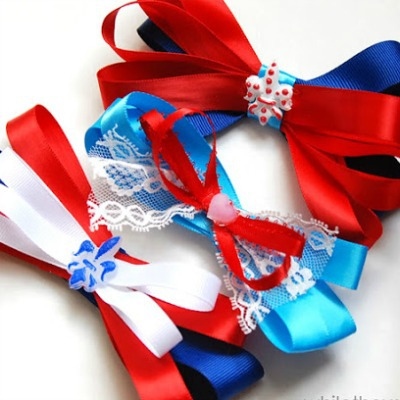 Three red, white, and blue hair bows