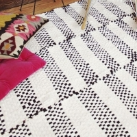 A black and white woven rug