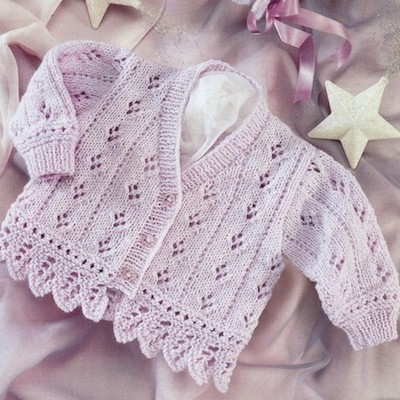 A lace-y cardigan in lavender with a matching bonnet