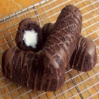 Three chocolate Twinkies stacked together