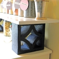 A shelf supported by concrete blocks spray painted black