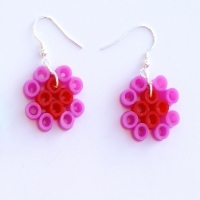 One set of earrings made from red and pink perler beads