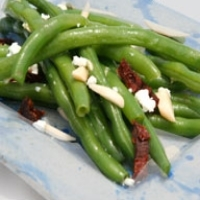 Green beans on a plate with goat cheese