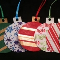Five different kinds of round Christmas ornaments, each made from a different type of patterned duct tape