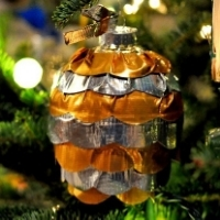 A Christmas bauble made from gold and silver strips of duct tape