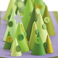 Several conical Christmas trees made out of green paper
