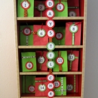 A CD tower decorated with red and green gift bags