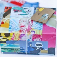A gift box wrapped in a magazine page