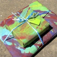 A gift wrapped in painted newspaper