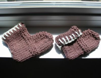 Two sets of simple booties, one blue and the other white