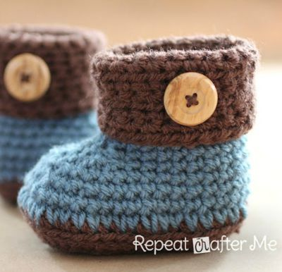 Blue booties with a brown cuff and beige decorative button