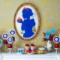 A refreshments table with a Snow White silhouette on the wall