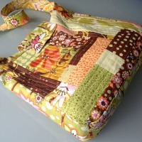 A patchwork tote bag made from scraps of different fabric