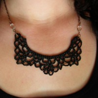 A necklace made of crocheted black lace