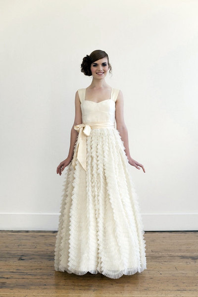 Woman in ruffled tulle wedding dress