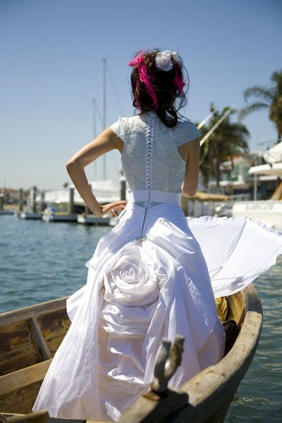 Woman in wedding dress on boat