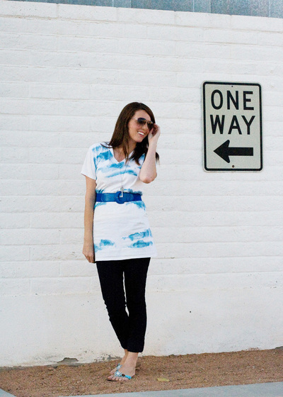 Woman wears blue and white summer tunic