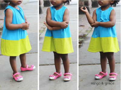 Child wears color-block shift dress