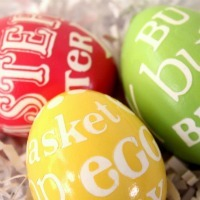 Eggs in bright red, yellow, and green with white lettering on them