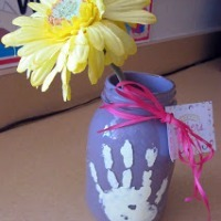 Handprint painted mason jar