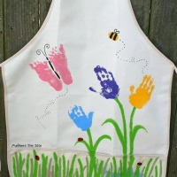 Apron decorated with flowers and butterflies made from handprints