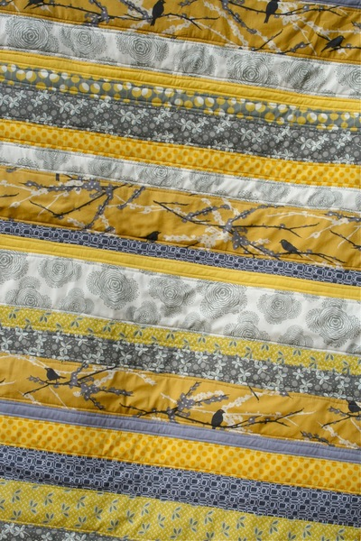 Gray and Yellow Strip Quilt
