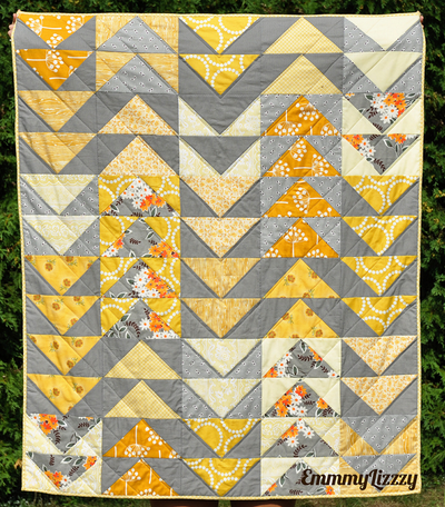 Gray and yellow flying geese quilt