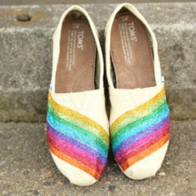 Canvas shoes decorated with rainbow tape
