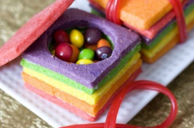 Rainbow sugar cookies stacked into a box