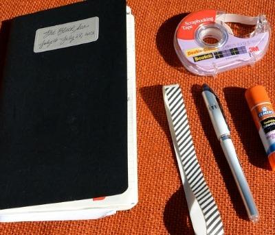 black travel journal