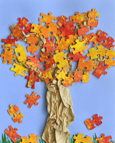 Tree with leaves made from puzzle pieces