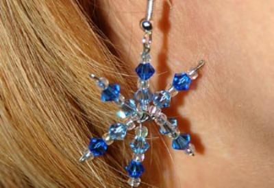 Blue bead snowflake earrings