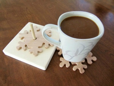 Wood snowflake coasters on spindle