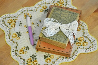 Lace bow wrapped antique books