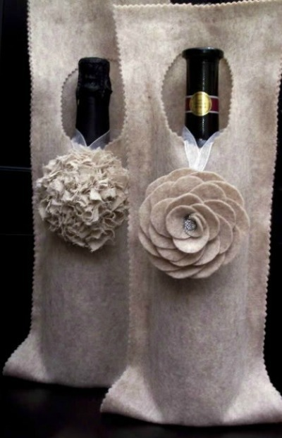 Felt wine bottle bags with rosettes
